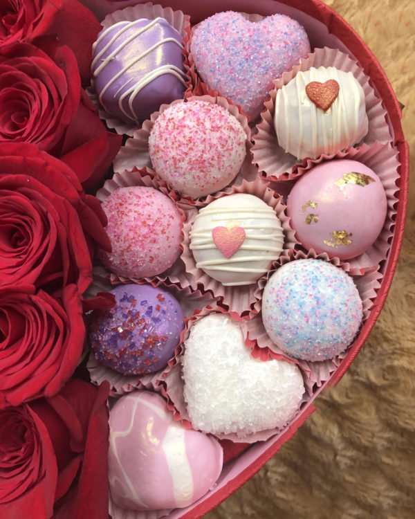 Beautiful Box filled with red roses and an assortment of cake bites in lemon, red velvet and chocolate chip.