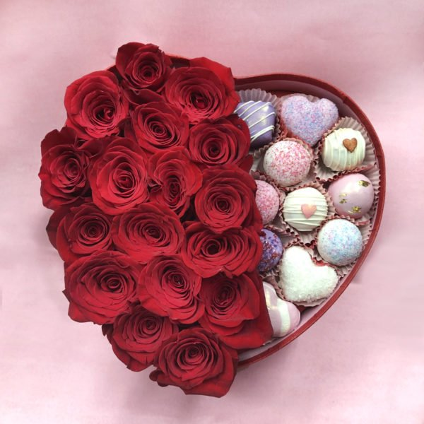 Beautiful box filled with valentine's day red roses and cake bites.